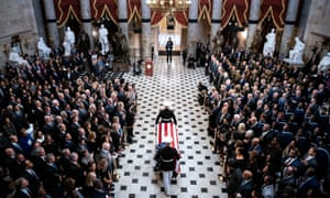 The casket of Elijah Cummings is carried through the National Statuary Hall during a memorial service at the US Capitol in Washington DC, on 24 October.