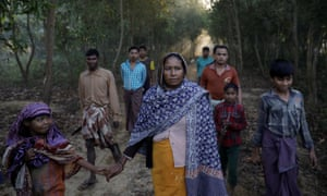 A Rohingya refugee walks with her daughter to cut firewood near the Palongkhali refugee camp in Bangladesh