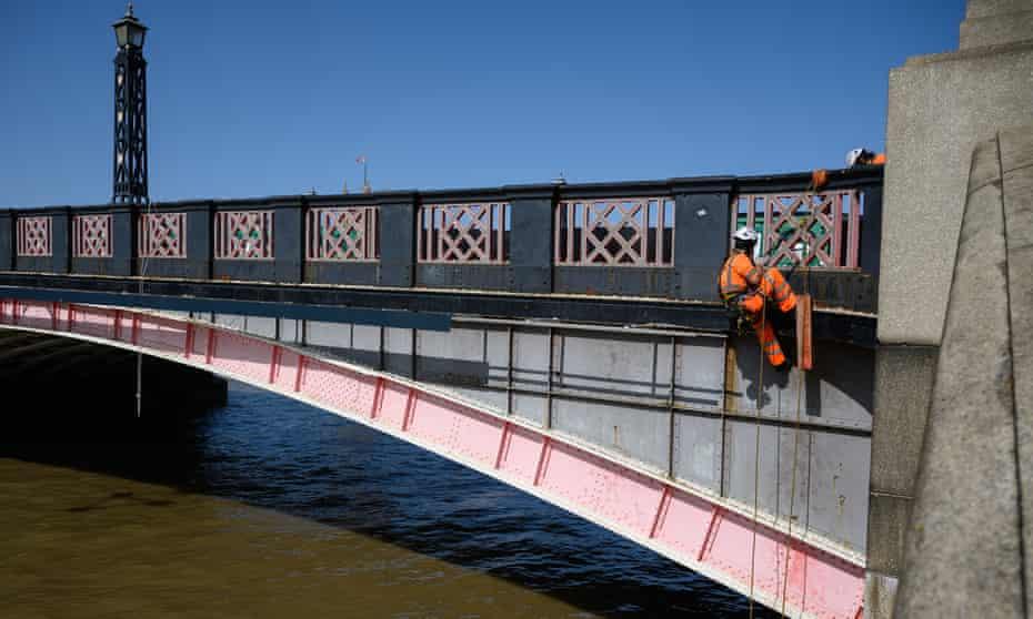 An engineer abseils from Lambeth Bridge, one of many London bridges in need of repair.