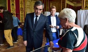 Fillon votes in Paris.
