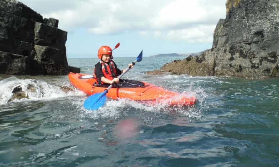 child on Wales sea kayaking holiday