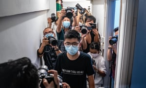 Pro-democracy activist Joshua Wong on Friday after his ban from standing for the council.