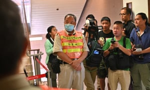 A group of reporters stand outside the intensive care unit of Queen Elizabeth Hospital in Hong Kong where Chow Tzk-lok died