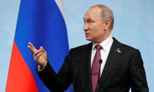 Vladimir Putin speaks during a news conference after the G20 summit.