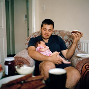 Vladimir and baby Sophia at home in Coseley, Dudley, August 2018.