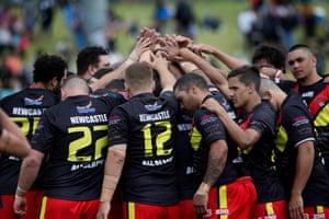 The Newcastle All Blacks huddle before the Koori Knockout grand final against the Redfern All Blacks