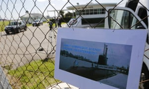 A picture of the Argentine submarine ARA San Juan hangs on the fence of the Mar del Plata naval base