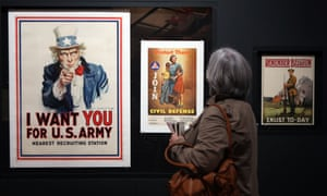 Propaganda: Power and Persuasion exhibition<br>A woman views a US Army poster which is on display as part of the Propaganda: Power and Persuasion exhibition at the British Library in central London. Photo credit should read: Steve Parsons/PA Wire