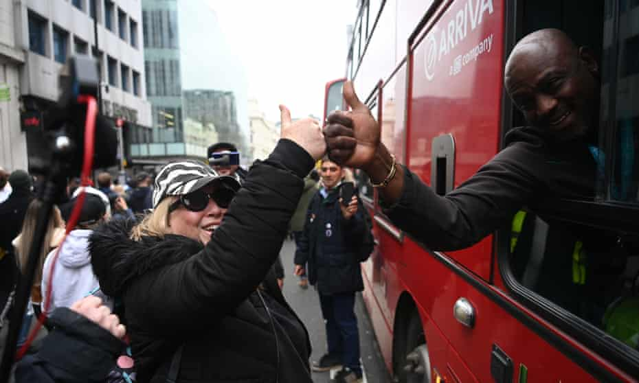 A woman and a bus driver during an anti-lockdown protest in London, 20 March 2021
