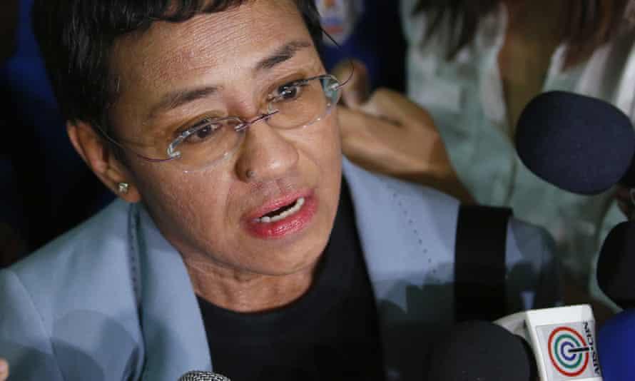 Maria Ressa speaking to journalists
