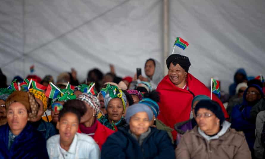 People gather in a tent at Mbekweni Rugby Stadium