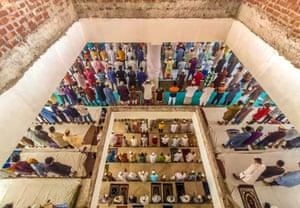 Barishal, Bangladesh. Muslim devotees attend Jummah prayers in a mosque in Barishal City