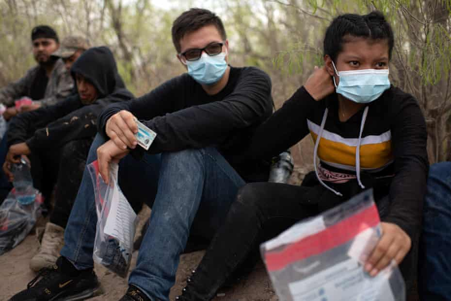 A group of people are detained while crossing the Rio Grande Valley in Texas.