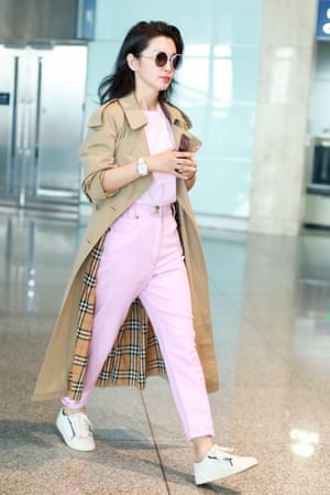 Actress Li Bingbing in an open Burberry trench coat and ice cream hues