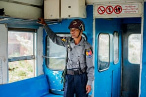 A policeman in the Buddhist section of the Sittwe-Zaw Pu Gyar train