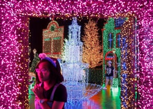 SingaporePeople tour a Christmas attraction featuring a display of more than 800,000 light bulbs at a Universal Studios theme park