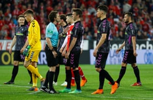 BSC Freiburg's Janik Haberer speaks with referee Guido Winkmann after the penalty is awarded to Mainz.