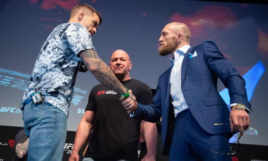 Dustin Poirier and Conor McGregor shake hands before UFC 257.