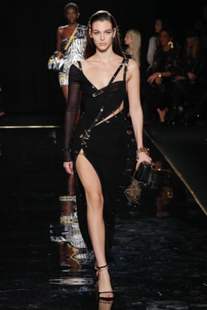 A Versace model walks the runway wearing an update of the Elizabeth Hurley dress.