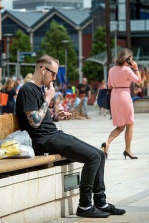 Man smoking in Millennium Square, Bristol
