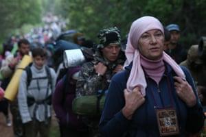 Pilgrims take part in the Velikoretsky religious procession