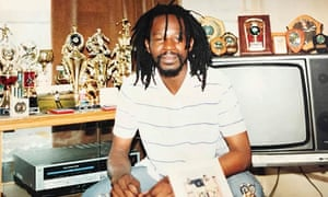 Errol Graham surrounded by his football trophies