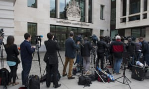 Reporters wait outside the court in London for a bail hearing of Navinder Singh Sarao, accused by US authorities of wire fraud, commodities fraud and market manipulation.