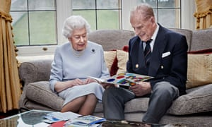 The Queen and Duke of Edinburgh reading a card handmade by their great-grandchildren, Prince George, Princess Charlotte and Prince Louis.
