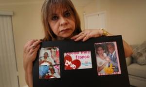 Margarita Navarro displays photographs of her parents.