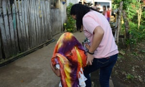 A child is led to safety during a joint operation between the International Justice Mission and Philippine law enforcement