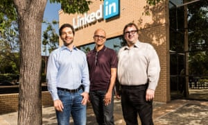 Jeff Weiner, CEO of LinkedIn (left) and chairman Reid Hoffman (right) with Satya Nadella, CEO of Microsoft (centre).