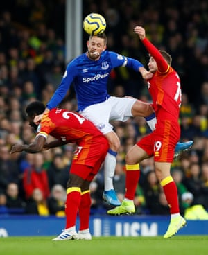 Everton's Gylfi Sigurdsson rises above Tom Trybull and Alexander Tettey of Norwich at Goodison Park. The Canaries won 2-0, condemning The Toffees to their seventh defeat of the season.