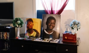 An alter in Dinyal New's home is filled with pictures of her slain sons, Lee Weathersby III and Lamar Broussard, killed within 19 days of each other.