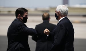 Republican leaders in masks!Vice President Mike Pence, right, is greeted with an elbow bump by Arizona governor Doug Ducey, left, as he arrives today in Phoenix to discuss the record surge in coronavirus cases.