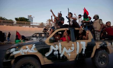 Rebal forces storm Gaddiffi's compund at Bab El Azayi in August 2011.