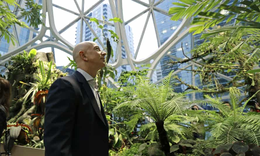 Jeff Bezos walks through the Amazon headquarters in Seattle