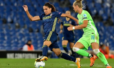 Lyon's Delphine Cascarino chased by Wolfsburg's Alexandra Popp in Women's Champions League final