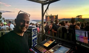 Sound engineer Shan Hira behind the mixing desk at a Liam Gallagher show in Tasmania in 2017.