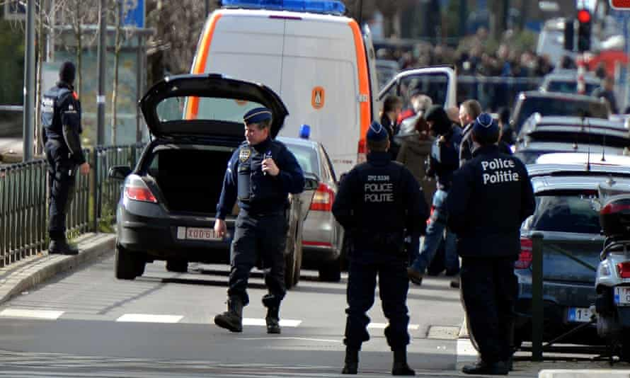 Belgian police take security measures after the terrorist attacks in Brussels earlier this year.
