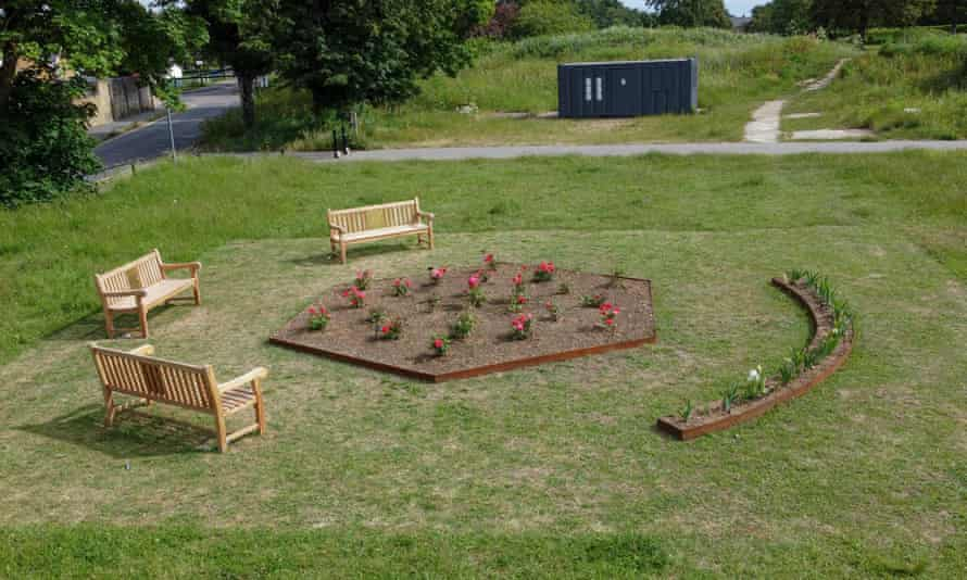 An English Garden by Gabriella Hirst in Gunners Park consisted of flowerbeds planted with Atom bomb roses and Cliffs of Dover irises, and three park benches.