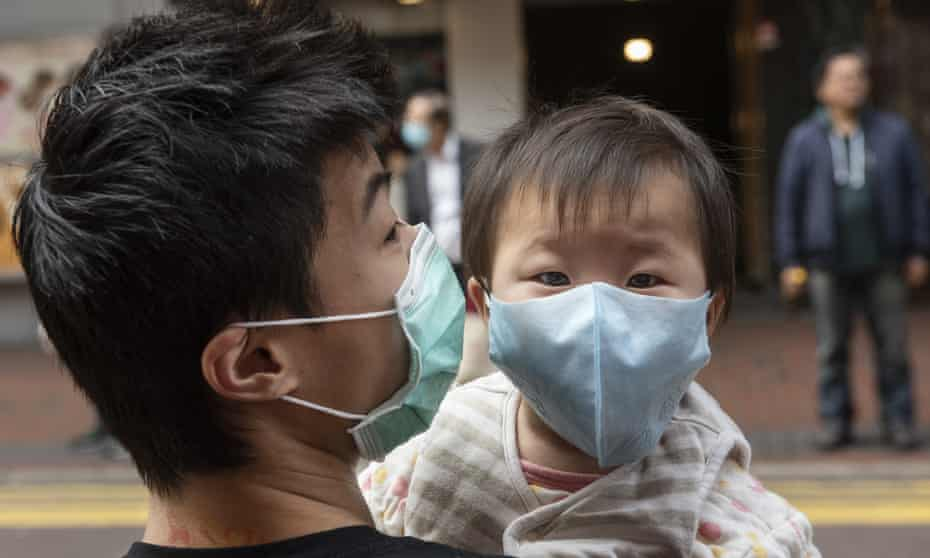 A father and son wear face masks to prevent infection in Hong Kong, China, on 3 February.
