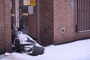 A homeless man tries to shelter from the storm in midtown Manhattan, New York City