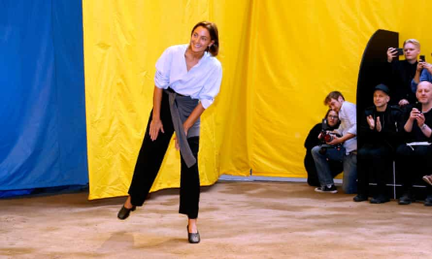 Phoebe Philo bowing after last year's spring show in Paris.