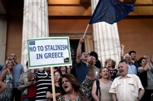"A protester holds a sign reading ""No Stalinism in Greece"" during a pro-European demonstration in front of the Greek parliament in Athens on June 18, 2015. Greece must make the next move towards reaching a debt deal with its EU-IMF creditors but there is little chance of an agreement at a meeting of eurozone finance ministers on June 18, Eurogroup chief Jeroen Dijsselbloem said. AFP PHOTO / ARIS MESSINISARIS MESSINIS/AFP/Getty Images"