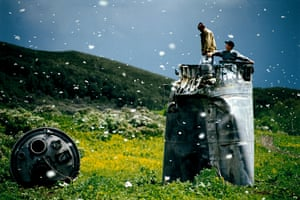 Villagers collecting scrap from a crashed spacecraft,