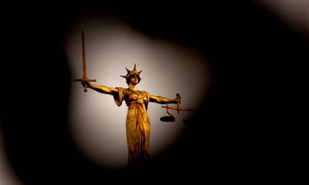 The Scales of Justice statue on top of the Old Bailey court in London