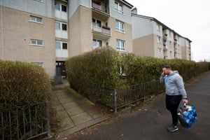 McGowan heads into a block of flats in Craigend.