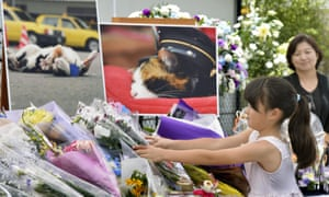 A girl lays a bouquet of flowers at an altar especially set up for a funeral of Tama on Sunday.