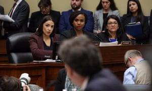 Representatives Alexandria Ocasio-Cortez, Ayanna Pressley and Rashida Tlaib listen to Michael Cohen's testimony.