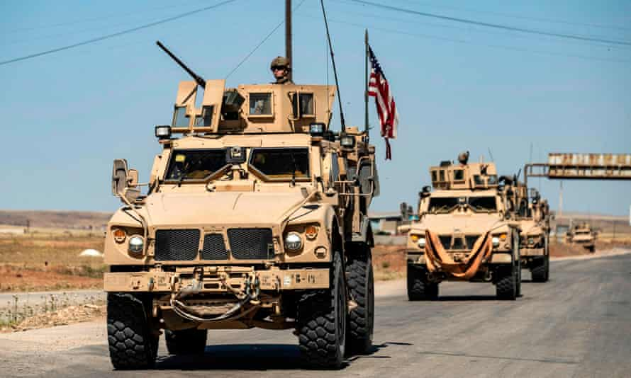 US military mine-resistant ambush protected vehicles drive in Syria, near the border with Turkey, on 20 May.